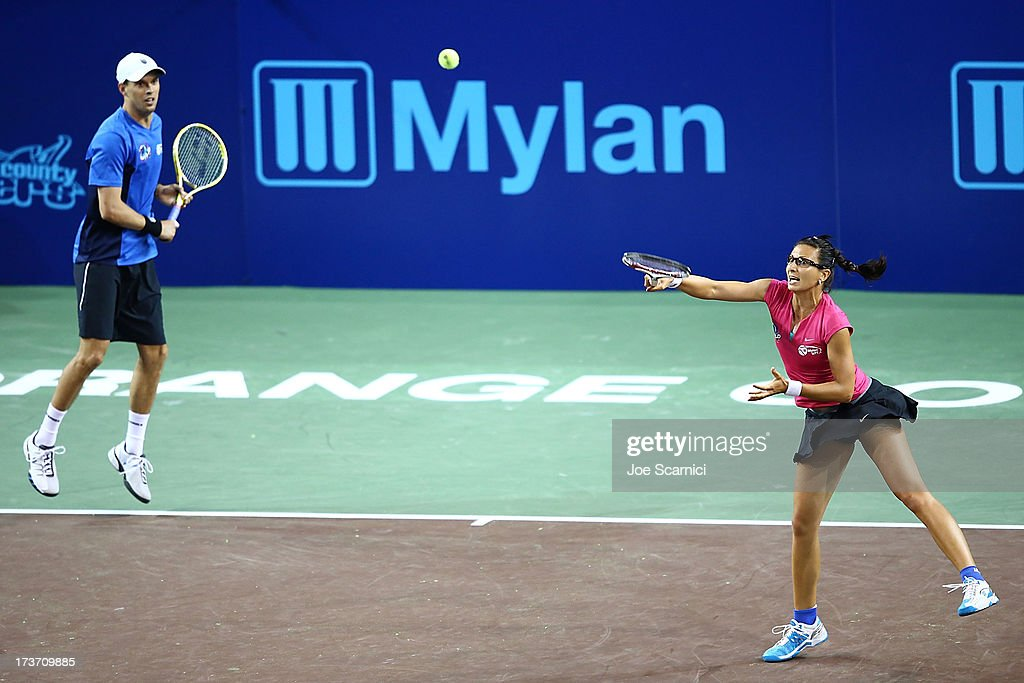 Darja Jurak returns a shot as <a gi-track='captionPersonalityLinkClicked' href=/galleries/search?phrase=Mike+Bryan+-+Tennis+Player&family=editorial&specificpeople=204456 ng-click='$event.stopPropagation()'>Mike Bryan</a> watches as the Texas Wild compete against the Orange County Breakers on July 16, 2013 in Newport Beach, California.