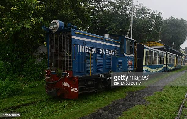 A Darjeeling Himalayan Railway Toy Train makes its way from the Indian town of Siliguri to Darjeeling on June 12 2015 The Darjeeling Himalayan...