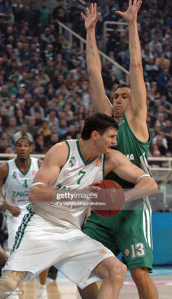 Darjus Lavrinovic, #7 of Zalgiris Kaunas competes with Dimitris Diamantidis, #13 of Panathinaikos Athens during the 2012-2013 Turkish Airlines Euroleague Top 16 Date 1 between Panathinaikos Athens v Zalgiris Kaunas at OAKA on December 28, 2012 in Athens, Greece.