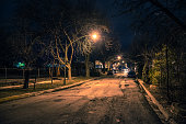 Dark and eerie urban city street at night
