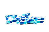 Dark and light blue gelatin capsules (gel caps) isolated on a white background.