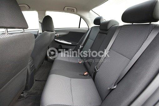 dark and light gray interior of a new car stock photo thinkstock