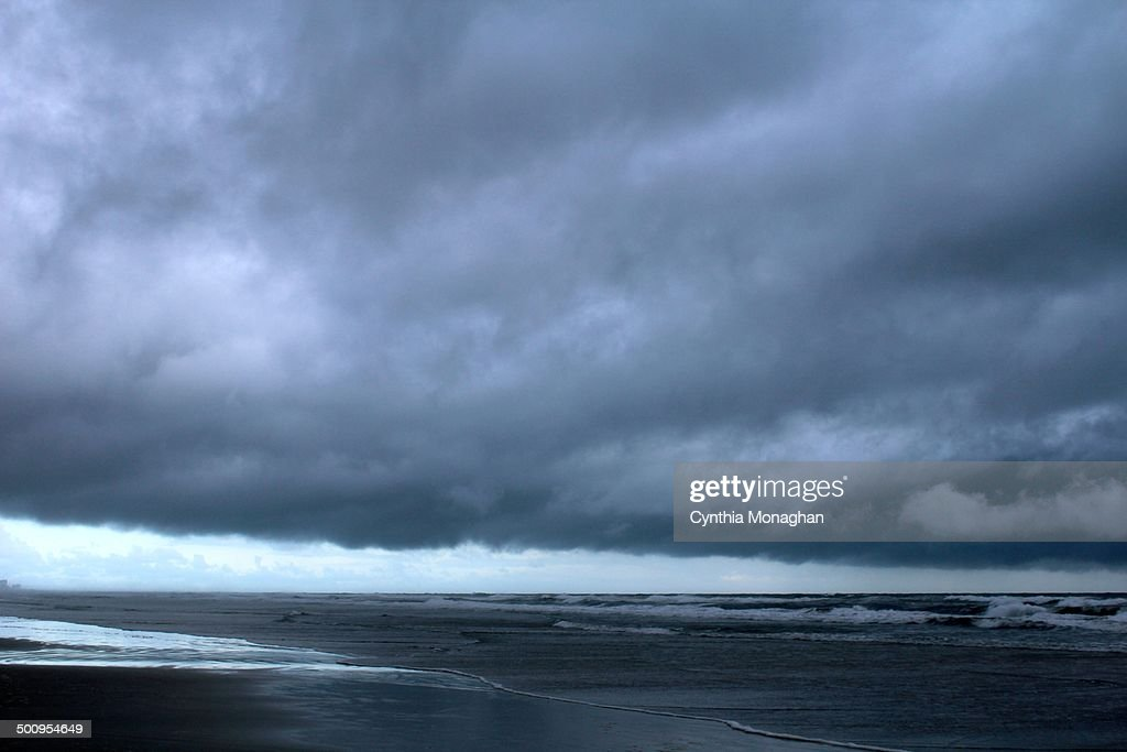 dark and stormy clouds off the coast of Ponce Inlet Florida as Tropical Storm / Hurricane Arthur passes through on July 2 2014