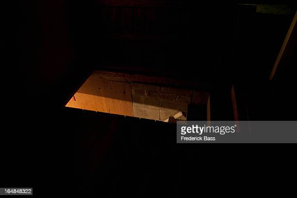 Dark attic with light seen through door