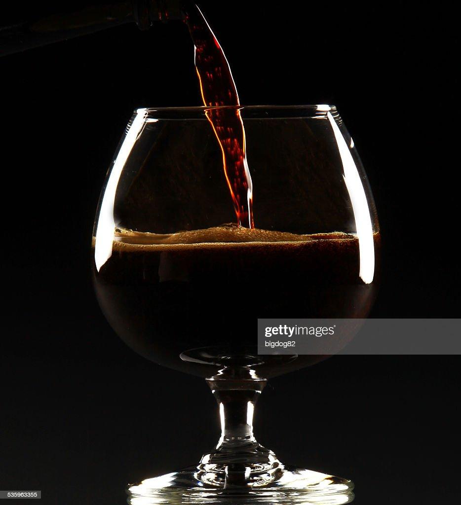 Dark beer in snifter : Stock Photo