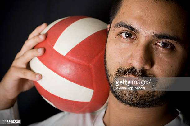 Dark Black Portrait of One Indian Youth with Vollyball Football