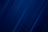Dark blue abstract diagonal blurred motion background with copy space.