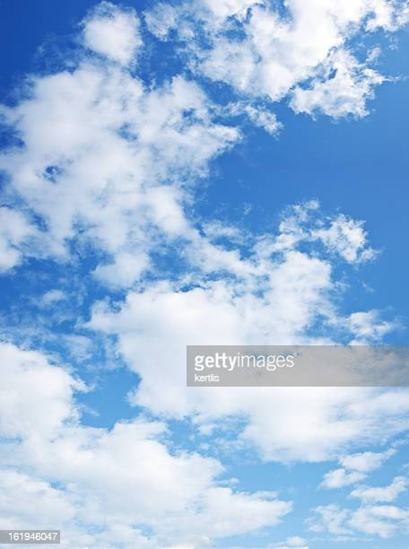 Dark blue sky with lots of white clouds