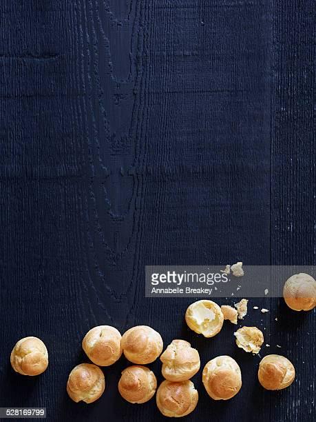 Dark Blue Wood Background with Profiteroles