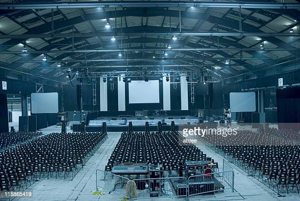 Dark blue-toned large empty auditorium hall