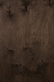 Wood texture on veneer surface dark brown walnut color