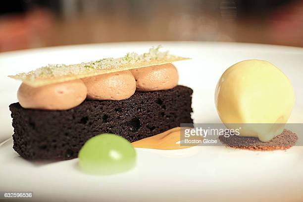 Dark chocolate brownie with milk chocolate mousse dulce de leche popcorn ice cream and lime is pictured at Parsnip restaurant in Cambridge MA on Feb...