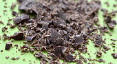 dark chocolate crumbs on green background,image of a