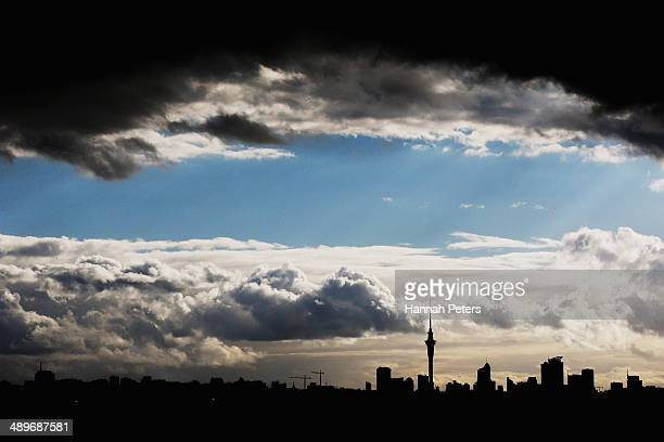 A dark cloud develops over Auckland city on May 12 2014 in Auckland New Zealand Finance Minister Bill English will deliver the federal budget...