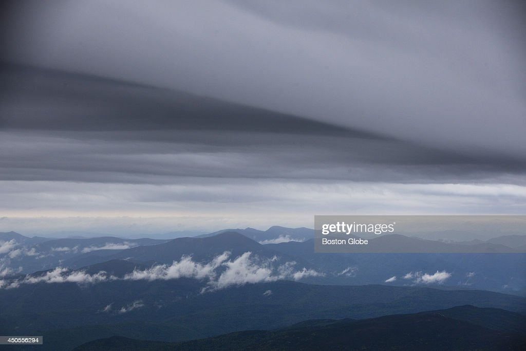 A dark cloud is seen approaching the Mount Washington Observatory and Museum on Thursday afternoon, June 12, 2014 in Coos County New Hampshire.