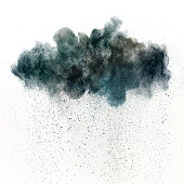 Dark cloud of a toxic substance, metaphor for pollution or acid rain. Dark particles falling from the cloud. Studio shot using high speed technique.
