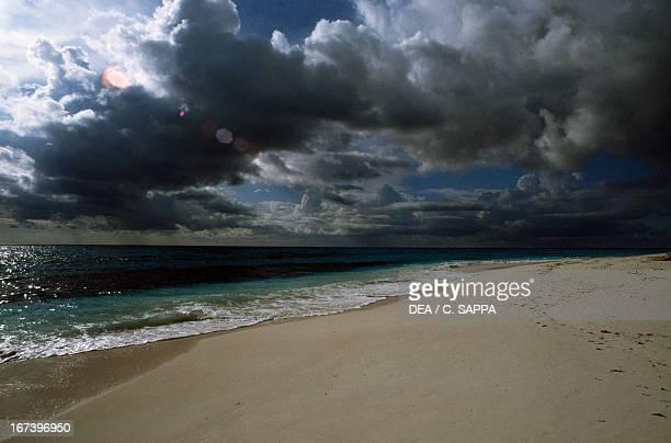 Dark clouds and storm approaching Bird Island Seychelles