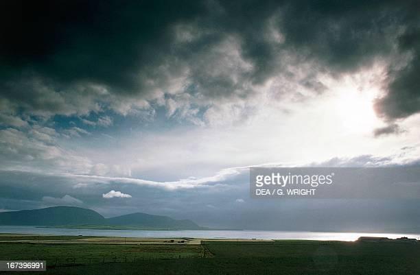 Dark clouds at sunset on Scapa Flow Orkney Islands Scotland United Kingdom
