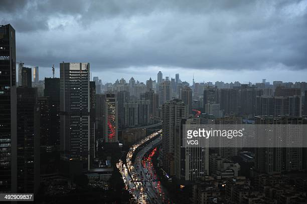 Dark clouds cover the city's skyline on May 22 2014 in Guangzhou Guangdong Province of China Heavy rainstorms expected to batter the southern cities...