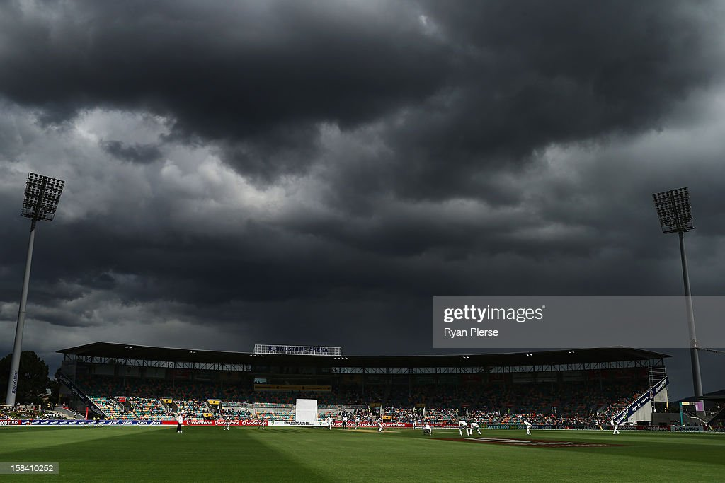 Dark clouds form over the ground during day three of the First Test match between Australia and Sri Lanka at Blundstone Arena on December 16, 2012 in Hobart, Australia.