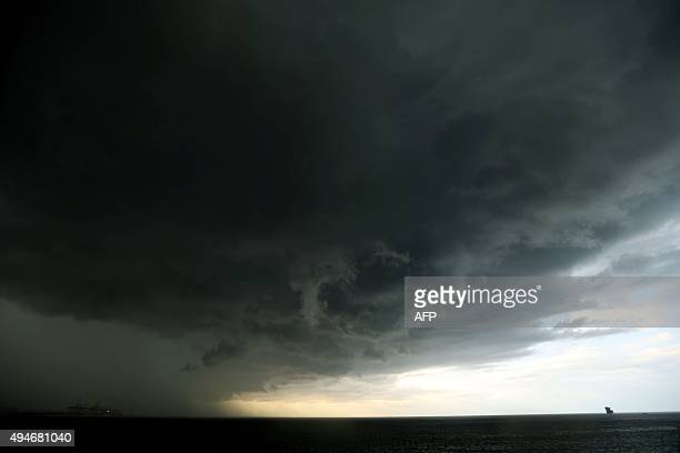 Dark clouds form over the Mediterranean sea in the Lebanese capital Beirut on October 28 2015 AFP PHOTO / JOSEPH EID / AFP / JOSEPH EID