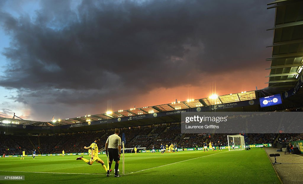 Dark clouds gather in the sky as Cesc Fabregas of Chelsea takes a corner kick during the Barclays Premier League match between Leicester City and...