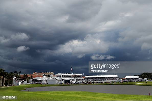Dark clouds gather over the grandstands surrounding the eighteenth hole during the third round of the World Golf ChampionshipsCadillac Championship...