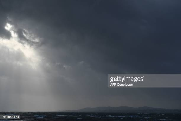 Dark clouds gather over the Irish Sea and Dublin on October 16 2017 as Ireland braces for the passing of the storm Ophelia Schools were closed on...
