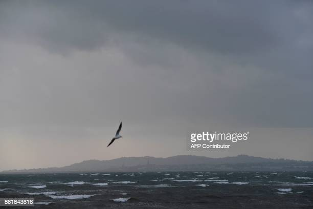 Dark clouds gather over the Irish Sea at Dublin Bay on October 16 2017 as Ireland braces for the passing of the storm Ophelia Schools were closed on...