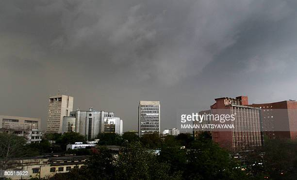 Dark clouds hover above the skyline of New Delhi on April 4 2008 The Indian capital experienced premonsoon showers bringing relief from hot and humid...