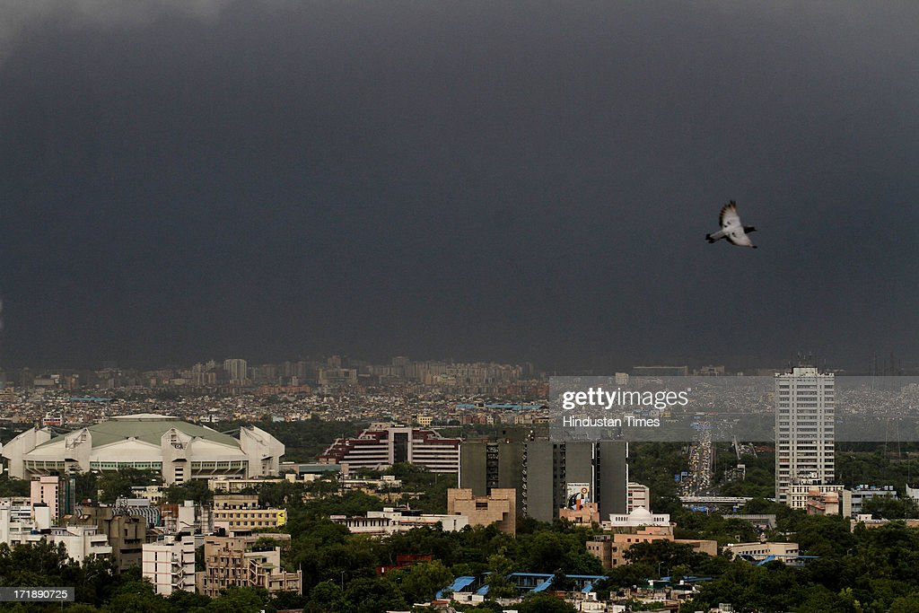 Dark clouds looms in sky before heavy rainfall after a hot and humid afternoon on June 29, 2013 in New Delhi, India. Weather department forecast the country will receive normal rains this year, raising prospects of a stronger performance by Asia's third-largest economy.