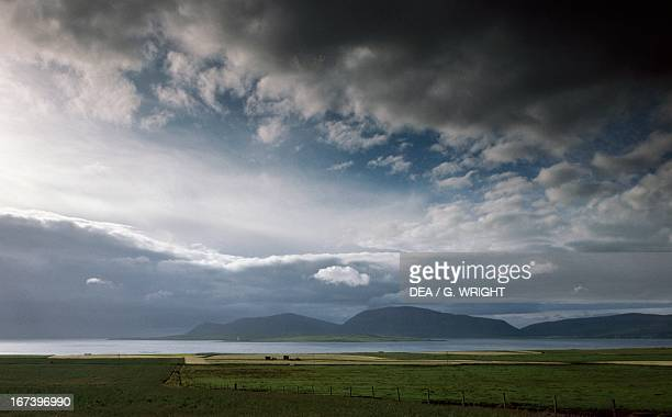 Dark clouds on Scapa Flow Orkney Islands Scotland United Kingdom