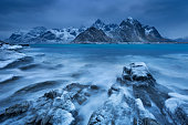 Dark clouds over a fjord near Vareid on the Lofoten in northern Norway on a cold day in winter.