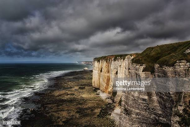 Dark clouds over the cliff line