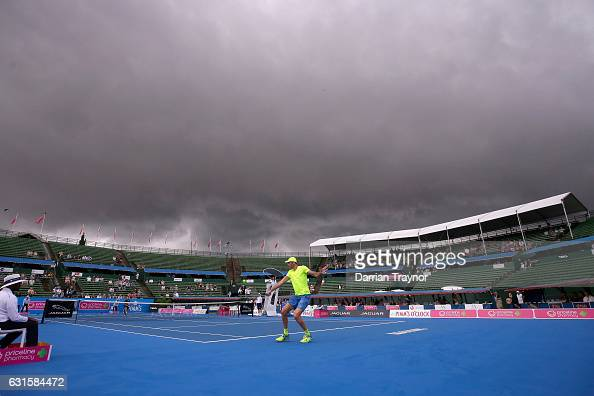 Dark clouds roll over the mens final between David Goffin of Belgium and Ivo Karlovic of Croatia during day four of the 2017 Priceline Pharmacy...