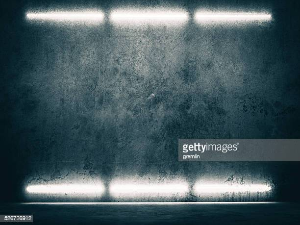 Dark concrete environment with top illumination