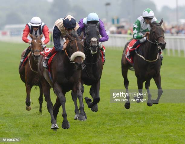 Dark Crusader and Fran Berry win the Betfred Melrose Stakes during day four of the 2013 Yorkshire Ebor Festival at York Racecourse York