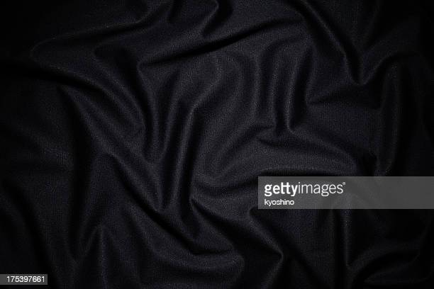 Dark fabric texture background with wave pattern