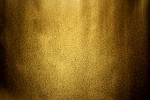 Dark gold texture background with spot light