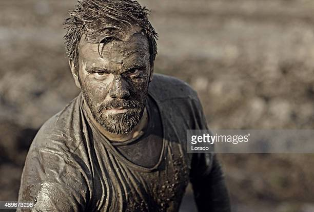 Dark haired man posing during a mud run
