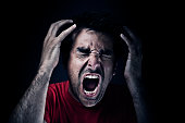 Dark man screaming