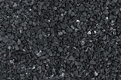 Dark pattern of gravel stone wall texture or background