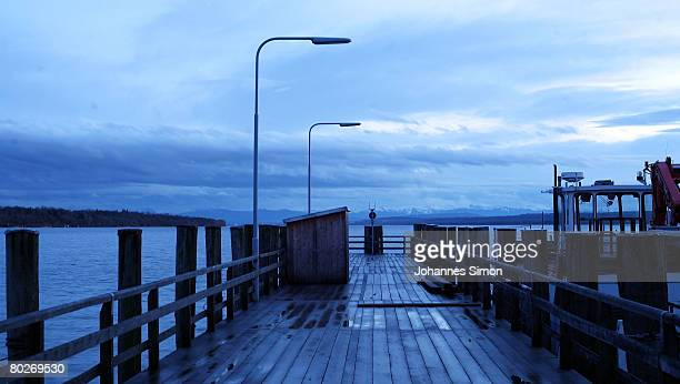 Dark rain clouds are seen over the Ammersee lake on March 16 2008 in Stegen am Ammersee Germany The weather forecasts predict wet rainy and regional...