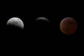 A dark red shadow crept across the moon leaving only a silver crescentshaped sliver as a total lunar eclipse began late Saturday Around the world...