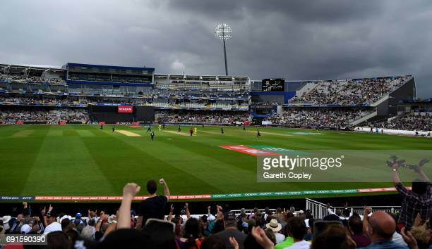 Dark skies approach as Adam Milne of New Zealand dismisses Aaron Finch of Australia during the ICC Champions Trophy match between Australia and New...