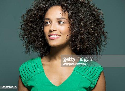 Dark skinned female, looking away