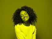 Dark skinned female smiling with eyes closed