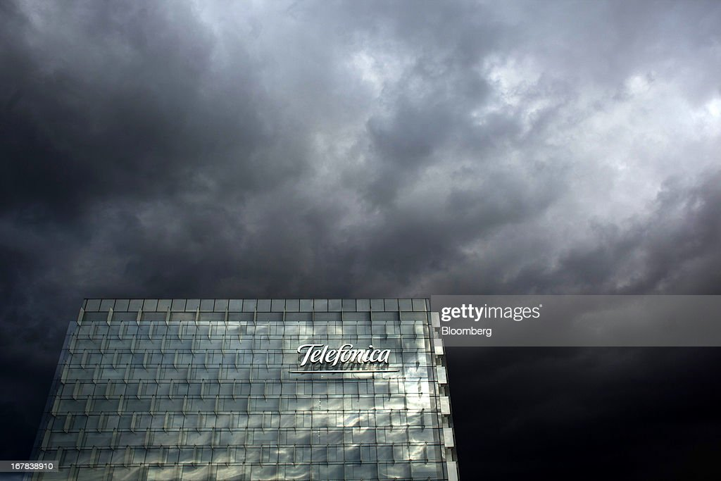 Dark storm clouds are seen over the top of the Telefonica SA headquarters in Madrid, Spain, on Tuesday, April 30, 2013. Telefonica SA, Spain's largest phone company, is considering sale options in Europe that range from fixed-line operations in Germany to its assets in Ireland, according to people familiar with the plans. Photographer: Angel Navarrete/Bloomberg via Getty Images