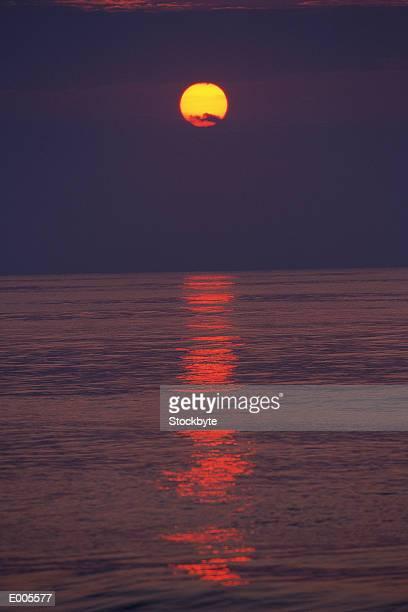 Dark sunset reflecting onto water