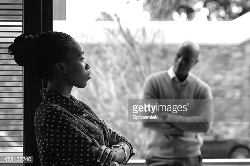 Dark toned image of angry couple not speaking